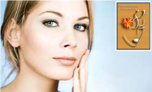advertisement picture showing a lady touching her face and the logo of the Enhancement Center Spa